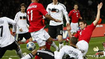 England's Matthew Upson, right, scores the opening goal