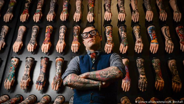 Curator in front of exhibition
