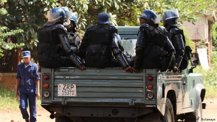 Zimbabwe police on the way to a protest against the election commission
