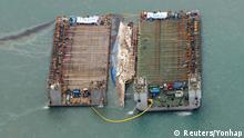 23.03.2017 *** The sunken ferry Sewol is seen during its salvage operations at the sea off Jindo, South Korea, March 23, 2017. Yonhap via REUTERS ATTENTION EDITORS - THIS IMAGE HAS BEEN SUPPLIED BY A THIRD PARTY. SOUTH KOREA OUT. FOR EDITORIAL USE ONLY. NO RESALES. NO ARCHIVE.