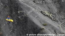 FILE - In this file photo dated Thursday, March 26, 2015, a rescue worker is lifted into a helicopter at the crash site near Seyne-les-Alpes, France. Duesseldorf prosecution on Monday, Jan. 9, 2017 confirmed that they stopped all investigations into the case without charging anybody. (AP Photo/Laurent Cipriani, file) |