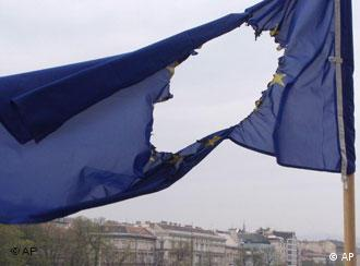 An EU flag blows in the wind after unidentified culprits burnt out the stars symbolizing the member states