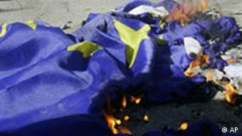 A burning EU flag