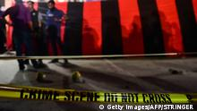 24.03.2017++Bangladesh police inspect the crime scene after an attacker was killed in front of a police box at the entrance to Dhakas international airport on March 24, 2017. A bomber was killed in a blast outside the Bangladeshi capital's main international airport on March 24, 2017, police said, the third in a series of suspected attacks since last week. The bomb, carried by a man on foot, exploded near a police checkpoint monitoring vehicles heading to Hazrat Shahjahal International Airport. The Islamic State group claimed the attack, saying a caliphate soldier in Bangladesh carried out a martyrdom operation with an explosive belt. / AFP PHOTO / STR (Photo credit should read STR/AFP/Getty Images)