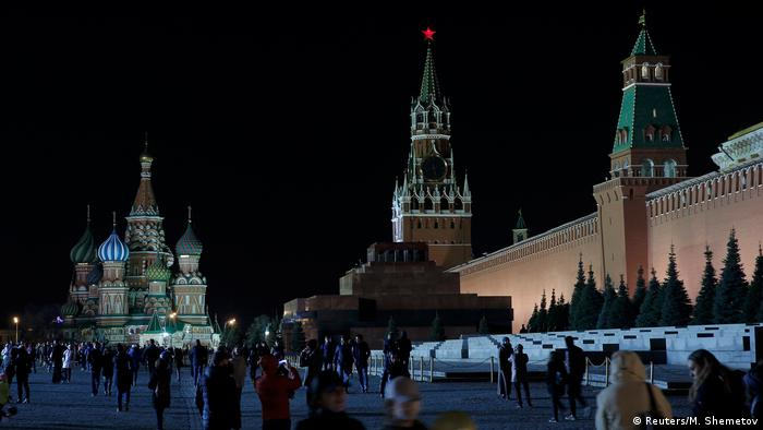 A view shows the St. Basil's Cathedral (left) and the Kremlin wall at night