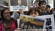 Pro-democracy protesters hold up placards with the picture of Carrie Lam, reading: Slave of Chinese Communist Party