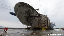 March 26, 2017 The sunken ferry Sewol sits on a semi-submersible ship during its salvage operations at the sea off Jindo, South Korea, in this handout picture provided by the Ministry of Oceans and Fisheries and released by Yonhap on March 26, 2017. The Ministry of Oceans and Fisheries/Yonhap via REUTERS ATTENTION EDITORS - THIS IMAGE HAS BEEN SUPPLIED BY A THIRD PARTY. SOUTH KOREA OUT. FOR EDITORIAL USE ONLY. NO RESALES. NO ARCHIVE. TPX IMAGES OF THE DAY