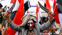 26.03.2017 A man waves traditional daggers, or Jambiyas, as he attends with supporters of the Houthi movement and Yemen's former president Ali Abdullah Saleh a rally to mark two years of the military intervention by the Saudi-led coalition, in Sanaa, Yemen March 26, 2017. REUTERS/Khaled Abdullah