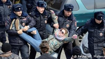 A young woman is carried off by police at opposition protest in Vladivostock (Reuters/Y. Maltev)