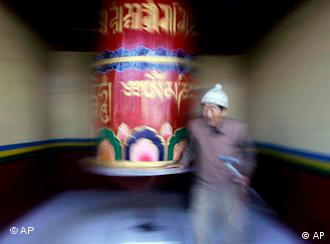 An elderly Tibetan exile spins a prayer wheel near the Tsangpa Monastery in Dharmsala, India, Saturday, Nov. 22, 2008. Tibetan leaders from across the world are meeting in a summit called by the Dalai Lama, after he publicly expressed frustration over the failure of his approach to yield greater autonomy for the region. China has meanwhile launched a new verbal attack on the Dalai Lama's drive for Tibetan autonomy on Friday, vowing not to compromise with leaders of the Tibetan exile community meeting to debate the future of their movement. (AP Photo/Altaf Qadri)