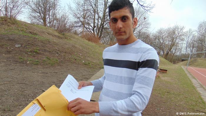 A young man holding documents