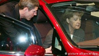 Merkel in a red Ford