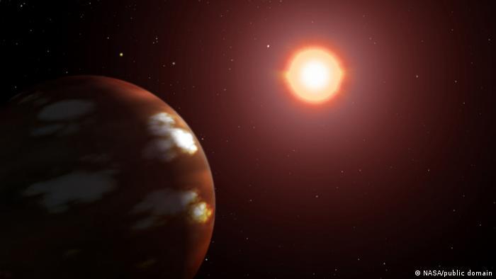 ഗ്ലൈസി 436 ബി യും അതിന്റെ നക്ഷത്രവും (നാസ / പബ്ലിക് ഡൊമെയ്ൻ) ആർട്ടിസ്റ്റിന്റെ മതിപ്പ്