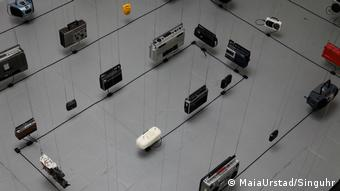 Maia Urstad's installation «Meanwhile, in Shanghai…» shows radio sets suspended from the ceiling