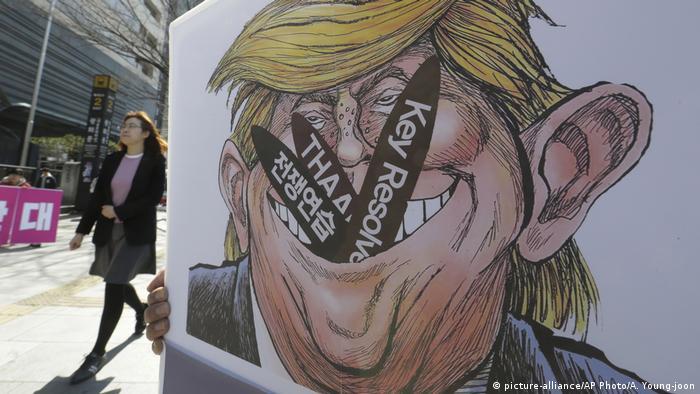 Südkorea Poster mit Karikatur von Donald Trump