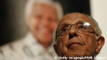 December 8, 2013 i Anti-apartheid activist and close friend of former South African President Nelson Mandela, Ahmed Kathrada, talks during a tribute to Mandela at Gandhi Hall, on December 8, 2013 in Johannesburg. The revered icon of the anti-apartheid struggle in South Africa and one of the towering political figures of the 20th century, died in Johannesburg on December 5 at age 95. Mandela, who was elected South Africa's first black president after spending nearly three decades in prison, had been receiving treatment for a lung infection at his Johannesburg home since September, after three months in hospital in a critical state. AFP PHOTO/MARCO LONGARI (Photo credit should read MARCO LONGARI/AFP/Getty Images)