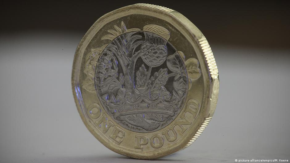 Britain's new 1-pound coin goes into circulation