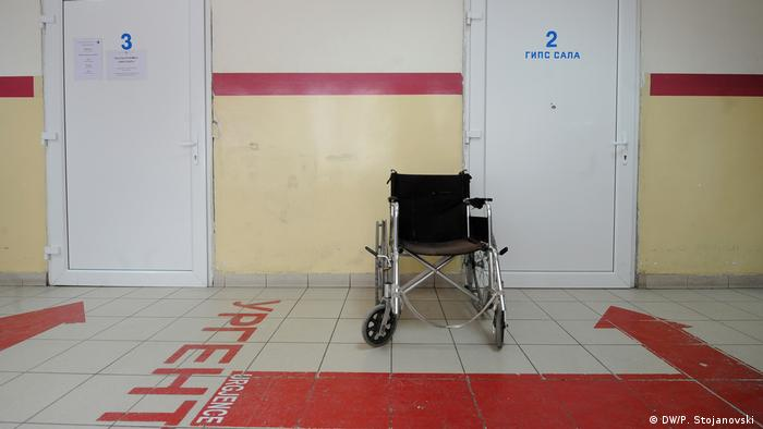 A scene in a hospital in Macedonia with an empty wheelchair