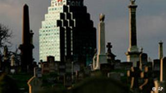 In this Nov. 17, 2008 file photo, an office tower bearing the Citigroup logo is seen beyond a cemetery in the Queens borough of New York. Shares of Citigroup Inc. climbed in premarket trading Friday, as the financial giant was said to be looking at selling off pieces of itself _ or the entire company _ to help rebuild investor confidence. (AP Photo/Seth Wenig, File