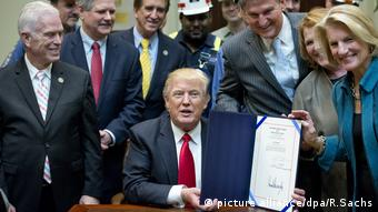 United States President Donald J. Trump signs H.J. Res. 38, disapproving the rule submitted by the US Department of the Interior known as the Stream Protection Rule