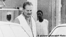 FILE- August 1994 file of Carlos The Jackal walking in the streets of Khartoum, Sudan. Carlos, whose real name is Ilich Ramirez Sanchez, the flamboyant terrorist and self-proclaimed revolutionary who was once one of the Cold War's most wanted men, is appealing Monday May 13, 2013 his two life sentences for orchestrating bombings in France two decades ago. He's been jailed since 1994 after French agents seized him in Sudan. (AP Photo/File) |