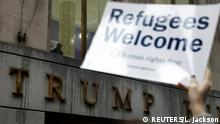 28.03.2017+++New York, USA+++ Protesters gather outside the Trump Building at 40 Wall St. to take action against America's refugee ban in New York City, U.S., March 28, 2017. REUTERS/Lucas Jackson