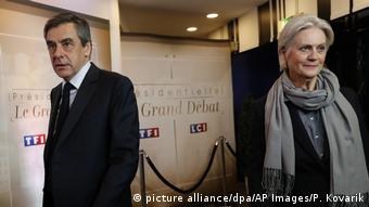 Conservative presidential candidate Francois Fillon (L) and his wife Penelope arrive for a television debate at French TV station TF1 in Aubervilliers, March 20.