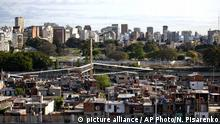 This Oct. 4, 2016 photo shows the Villa 31 neighborhood, backdropped by downtown, as well as middle class apartments and office buildings in Buenos Aires, Argentina. Many of the country's poor live in the slums known as Misery Villages, where they often lack access to transportation, running water or sewage. (AP Photo/Natacha Pisarenko) |
