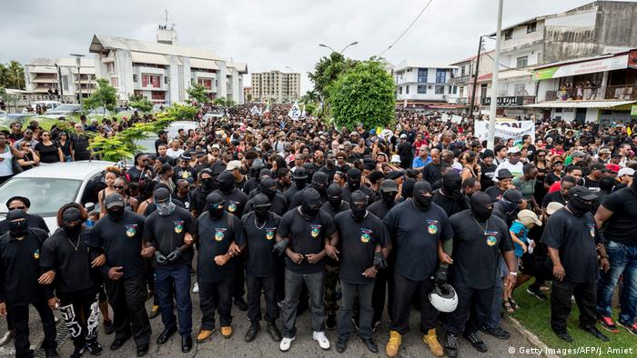 Members of The 500 Brothers take part in a march in support of the general strike in Cayenne, March 28.