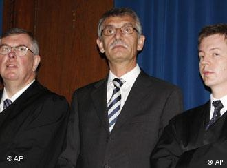 Feldmayer, center, former member of the board of Siemens group, center, stands with his lawyers Holger Zebisch, right, and Martin Raymann, left
