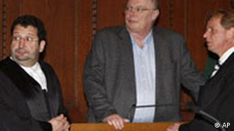 Wilhelm Schelsky, center, with his legal team