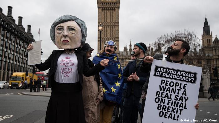 Pro-EU protesters hold signs calling for Brits to get a 'real say' on Brexit