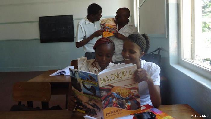 Children reading a magazine