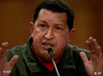Venezuela's President Hugo Chavez gestures during a news conference with foreign media members at Miraflores presidential palace in Caracas, Monday, Nov. 24, 2008. Chavez's allies won a majority in Venezuela's Sunday local elections, but the opposition made important gains, capturing the Caracas mayor's office and two of the most populous states. (AP Photo/Fernando Llano
