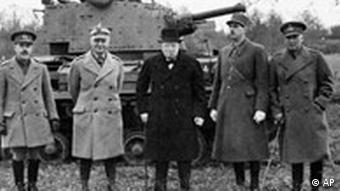 Black and white,1941 picture of Polish Gen. Wladyslaw Sikorski, British Prime Minister Winston Churchill, and French Gen. Charles De Gaulle, posing in front of a tank