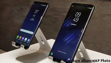 In this Friday, March 24, 2017, photo, new Samsung Galaxy S8, left, and Galaxy S8 Plus mobile phones are displayed in New York. The Galaxy S8 features a larger display than its predecessor, the Galaxy S7, and sports a voice assistant intended to rival Siri and Google Assistant. (AP Photo/Richard Drew) |
