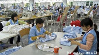 Vietnamese workers in Hanoi produce garments for a German textile company