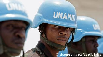 Head shot of three blue-helmeted UN soldiers in Darfur.