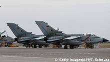 German Tornado jets are pictured on the groung at the air base in Incirlik, Turkey, on January 21, 2016. / AFP / POOL / TOBIAS SCHWARZ (Photo credit should read TOBIAS SCHWARZ/AFP/Getty Images)