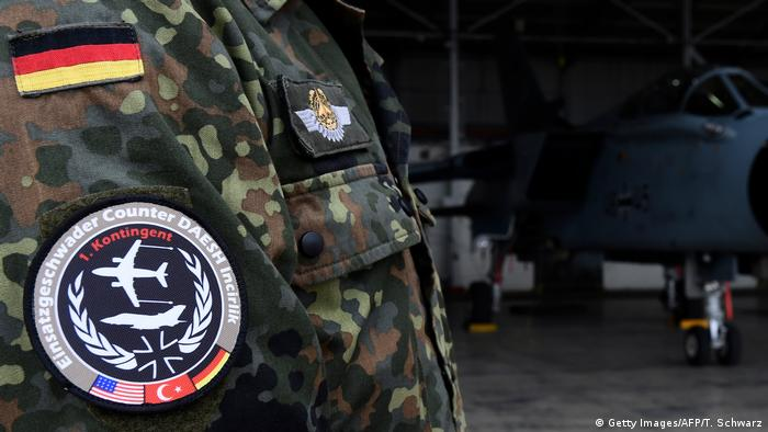A Bundeswehr soldier wears a badge of the combat wing Counter DAESH Incirlek