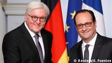 30.03.2017 *** French President Francois Hollande (R) and German President Frank-Walter Steinmeier attend a joint news conference after a meeting at the Elysee Palace in Paris, France, March 30, 2017. REUTERS/Gonzalo Fuentes