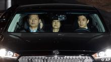 Ousted South Korean President Park Geun-hye, center, leaves the prosecutors' office as she is transferred to a detention house in Seoul (AP)