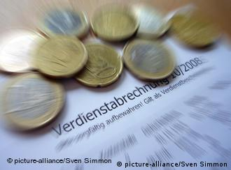 Euro coins and a pay slip