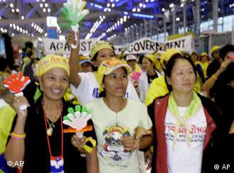Anti-government protesters shout and cheer during a protest at Suvarnabhumi international airport