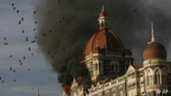 Pigeons fly above the Taj Mahal Hotel during the Mumbai attacks