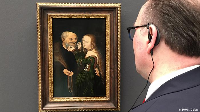 Painting of a young girl pulling on a man's beard (DW/S. Oelze)