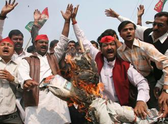 Angry Indians burn a terrorist's effigy after the Mumbai attacks