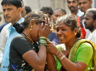 Two Indian women crying