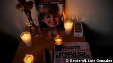 An altar for slain journalist Miroslava Breach is seen at the entrance to Norte of Ciudad Juarez newspaper in Ciudad Juarez, Mexico March 24, 2017. REUTERS/Jose Luis Gonzalez