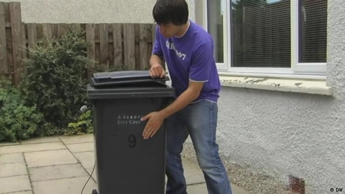 James Provan playing music with trash can (DW)